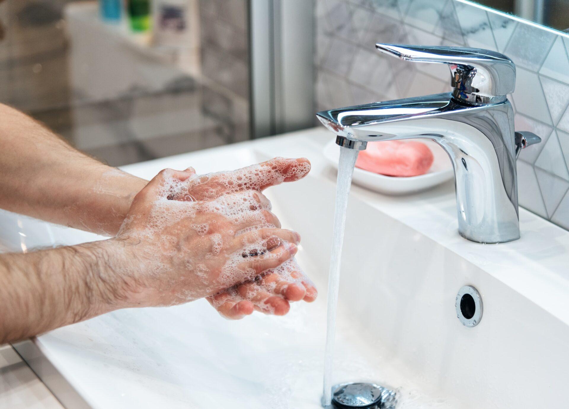 Man is washing hands with soap. Coronavirus pandemic. Covid-19