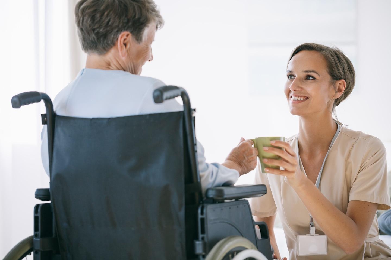 Nurse woman reading a book on nursing home