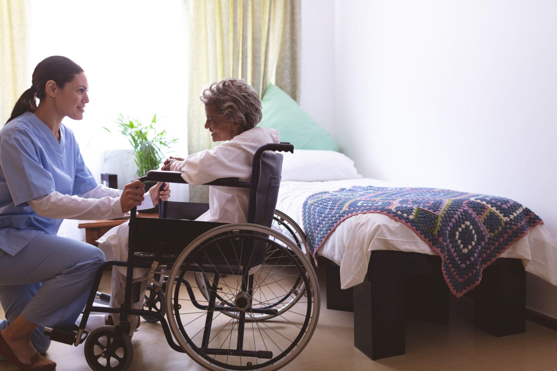 Nurse talking with senior female patient at nursing home